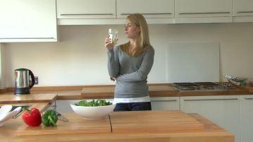 850392287-thirst-juice-looking-away-kitchen